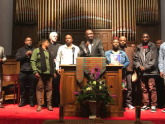 """During prayer vigil, noted civil rights attorney Benjamin Crump Jr. (at podium) with area leaders and family members of 21-year-old Emantic Fitzgerald """"E.J."""" Bradford Jr. who was killed Thanksgiving night by a Hoover police officer inside the Riverchase Galleria. (Erica Wright Photo, For The Birmingham Times)"""