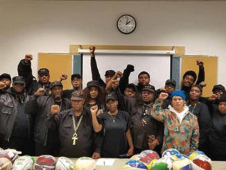 The Original Black Panthers of Milwaukee host their third annual New Coat, Hat and Turkey Giveaway. (Photo by Dylan Deprey)