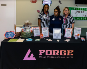 "Forge staff hosted ""Forge Football Frenzy"" booth highlighting a healthy tailgating recipe. (Lloyd E. Beard Photo, Forge)"