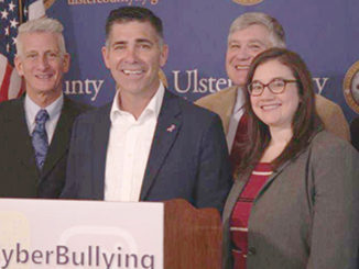 Activist Jeff Rindler and Ulster County Executive Michael Hein (2nd & 3rd from left) in solidarity with the awareness campaign pose for a photo as they announced a social media campaign, #EndCyberBullying.