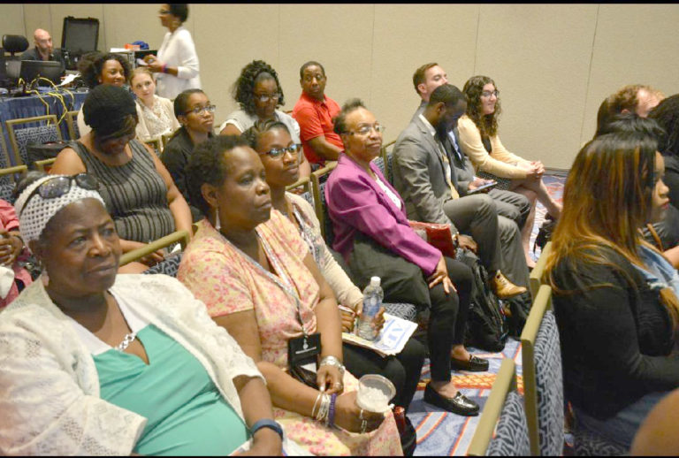 Parents listening intently at recent Black Parents' Town Hall meeting