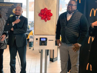 McDonald's operator James Thrower II, City Councilwoman Mary Sheffield, NBL president Ken Harris and a rep from the mayor's office unveiling the new self-service kiosk.