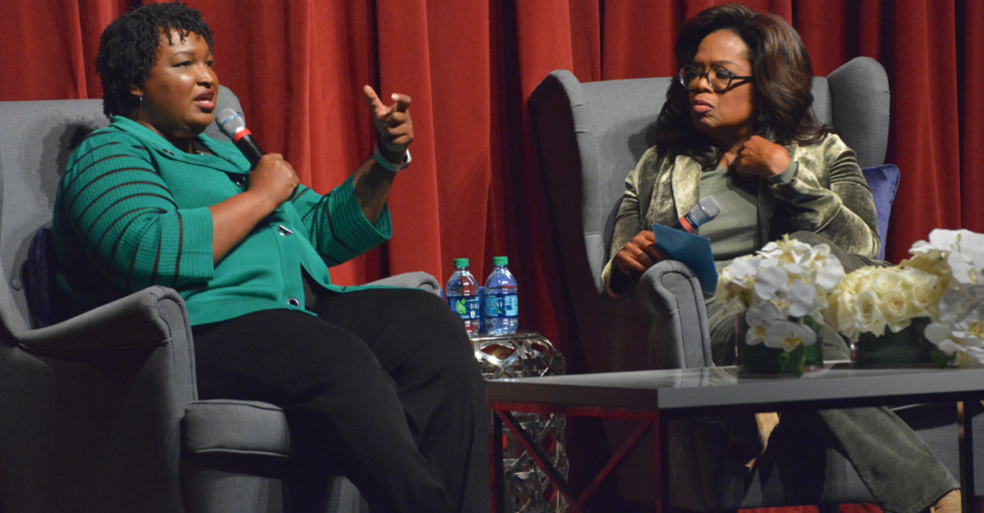 Stacey Abrams (left) speaks as Oprah Winfrey listens during their conversation at the Porter Sanford Arts and Community Center in Decatur on Thursday, November 1, 2018. (Photo: Itoro N. Umontuen / The Atlanta Voice)