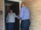 Colin Allred surprises a voter on Friday afternoon while canvassing neighborhoods to explain why he deserves their vote.