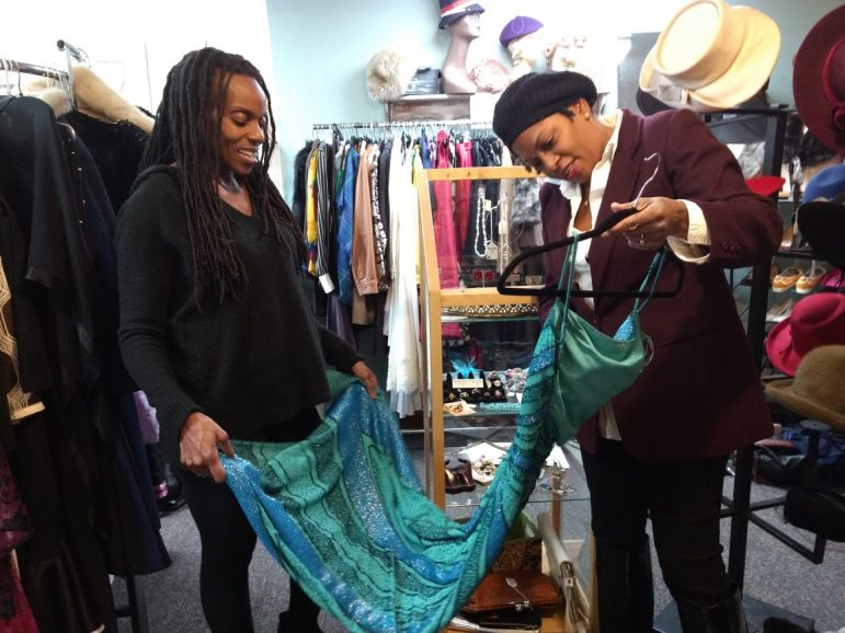 Autumn Frazier (right) shows a vintage beaded gown in her shop