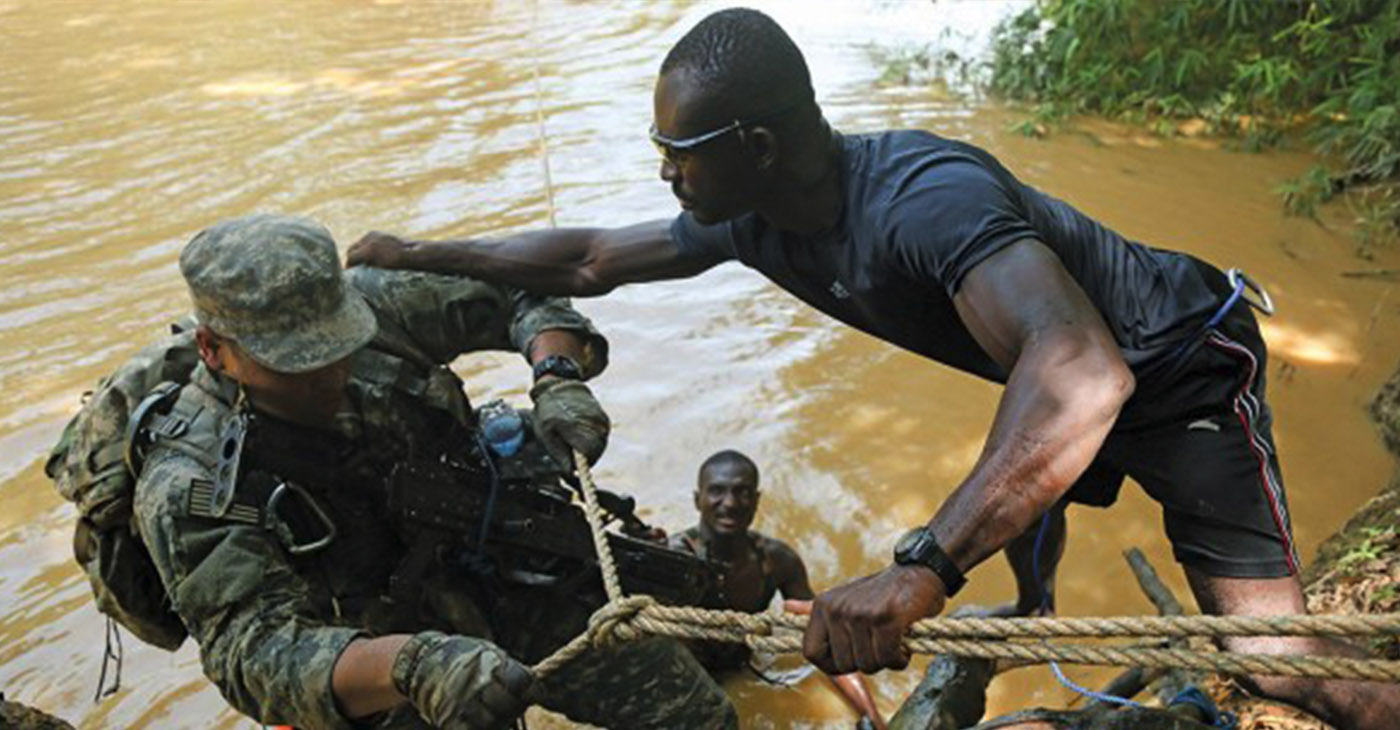 Turnaround is fair play. Usually, the trainers are American, training African soldiers. Here, the trainer is Ghanaian, showing a U.S. soldier with the 101st Airborne Division (Air Assault) how it's done in Africa. – Photo: Africom.mil