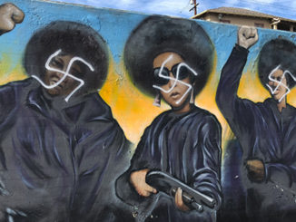 """""""Our Mighty Contribution"""" defaced by swastikas"""