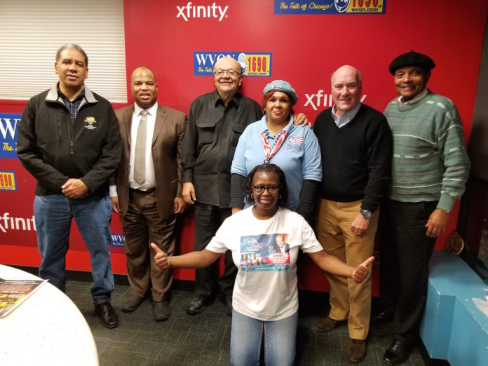 """ARTICIPANTS FROM THE November 17 America's Heroes Group broadcast from l-r: Colonel Damon Arnold MD, Sean Claiborne, Cliff Kelley, Rochelle Crump, William """"Bill"""" Daley and Attorney Ernesto Borges. Kneeling is Glenda Smith."""