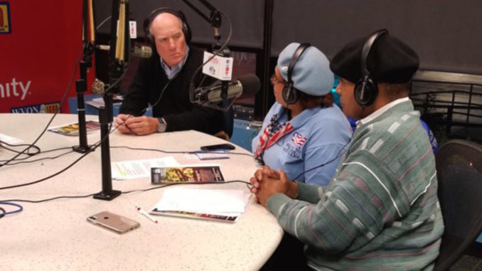 BILL DALEY IN the studio is pictured with Rochelle Crump, President and Founder of National Women Veterans United and panlist Attorney Ernesto Borges.