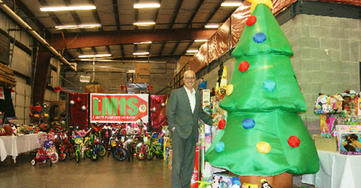 Nashville Sheriff Daron Hall in the warehouse holding a fraction of the toys being provided for the Last Minute Toy Store.