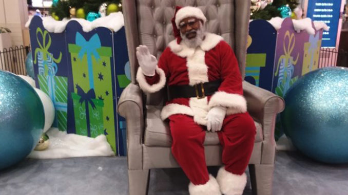 David Hendrix is Santa Claus at the Baldwin Hills Crenshaw Plaza. (Photo By Brian W. Carter)