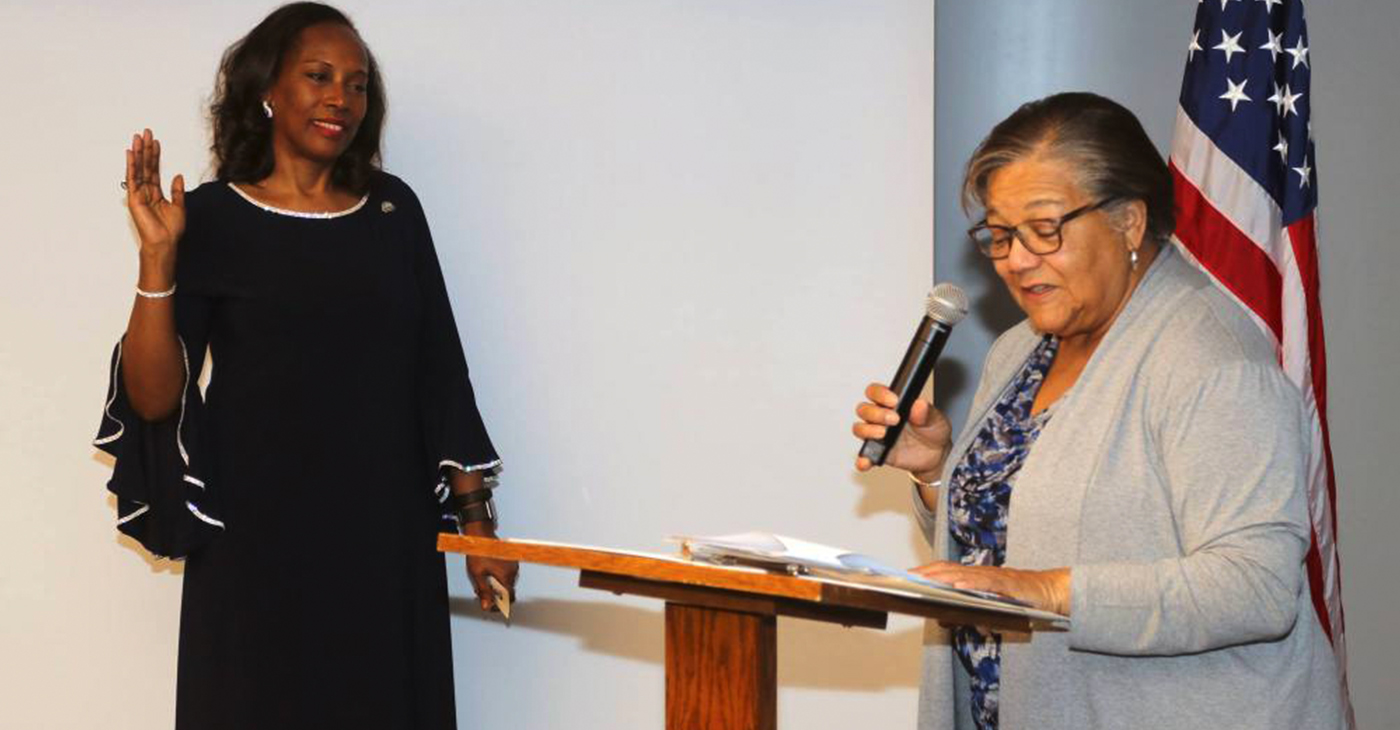 D.C. Council member Anita Bonds swearing in Dianah Shaw as the President of the District of Columbia Association of Realtors. (Courtesy Photo)