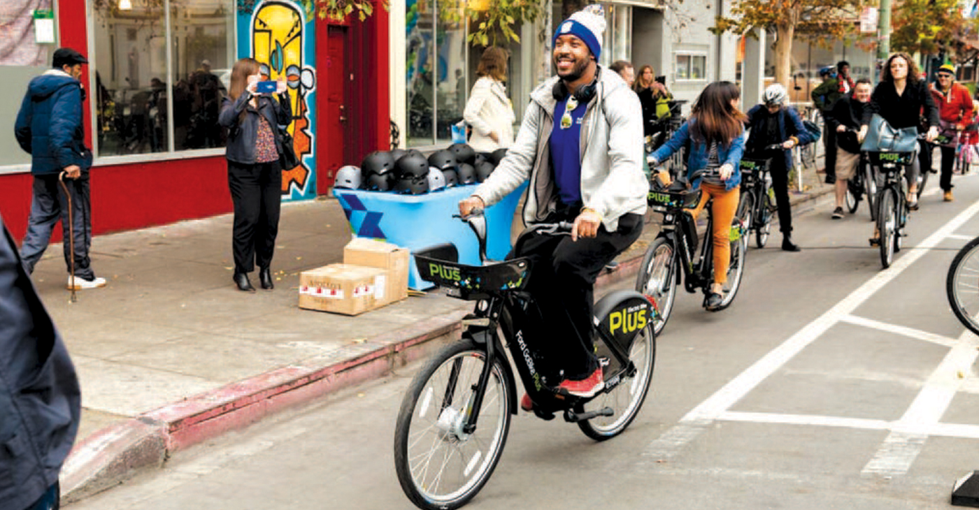 Bike enthusiast try out the Ford ebike at the launch in Oakland Dec. 14. Photo by Ford GoBike.