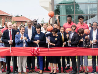 D.C. Mayor Muriel Bowser, Council members Jack Evans (D-Ward 2), Anita Bonds (D-At Large), Kenyan McDuffie (D-Ward 5), Brandon Todd (D-Ward 4) and Trayon White (D-Ward 8), Ed Fisher, executive director of St. Elizabeths East Campus, and Greg O'Dell, president and CEO of EventsDC, along with other officials and Ward 8 residents, cut the ribbon for the new Sports and Entertainment Arena in Southeast on Sept 22. (Shevry Lassiter/The Washington Informer)