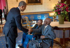 President Barack Obama greets Richard Overton, with Earlene Love-Karo, in the Blue Room of the White House, Nov. 11, 2013. Mr. Overton, 107, is the oldest living World War II veteran and was attending the Veteran's Day Breakfast at the White House. (Official White House Photo by Lawrence Jackson)  This official White House photograph is being made available only for publication by news organizations and/or for personal use printing by the subject(s) of the photograph. The photograph may not be manipulated in any way and may not be used in commercial or political materials, advertisements, emails, products, promotions that in any way suggests approval or endorsement of the President, the First Family, or the White House.