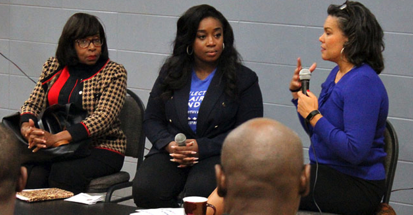 Carolyn King Arnold (at left) and Keyaira D. Saunders (middle) respond to questions from event moderator Cydney Walker during a forum held at the Moorland Family YMCA Tuesday night. The two are vying to replace Dwaine Caraway at the District 4 seat on the Dallas City Council. (Photo: David Wilfong)