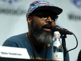 "Salim Akil speaking at the 2018 WonderCon, for ""Black Lightning"", at the Anaheim Convention Center in Anaheim, California"