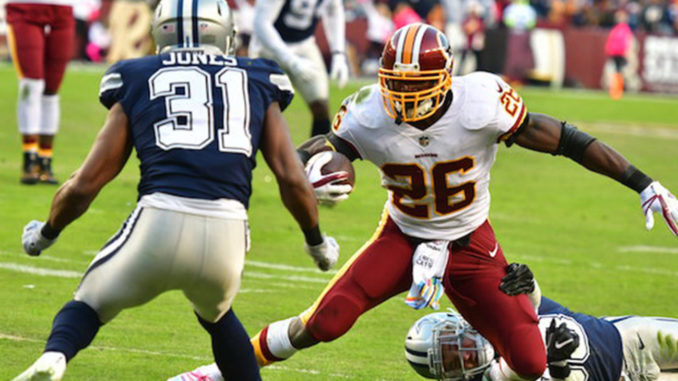 Washington Redskins running back Adrian Peterson attempts to juke Dallas cornerback Byron Jones during the Redskins' 20-17 win at FedEx Field at Landover, Md., on Oct 21. (John E. De Freitas/The Washington Informer)