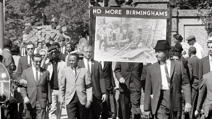 "Congress of Racial Equality and members of the All Souls Church, Unitarian located in Washington, D.C. march in memory of the 16th Street Baptist Church bombing victims. The banner, which says ""No more Birminghams"", shows a picture of the aftermath of the bombing. (Photo: US News & World Report Collection, US Library of Congress / Wikimedia Commons)"