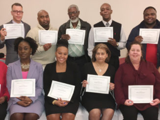 Project L.I.F.E. staff pose with their certificates at their their 1st Annual Christmas Recognition Banquet. By Journalist Ms. Jones