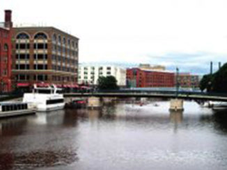 Old factories along the Milwaukee River have been converted to apartments. Photo by Derrick Brown.