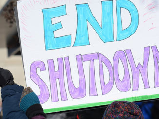 Hundreds rally at the White House for an end to the government shutdown. Protest of United States federal government shutdown of 2018–2019. Hundreds rally at the White House for an end to the government shutdown. (Photo by: AFGE | Wiki Commons)
