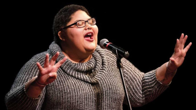 "Tanesha Nicole reads a poem at a ""Button Poetry Live"" at Park Square Theatre in St. Paul clinching top honors for the night. (Photo by: Jeff Wheeler)"