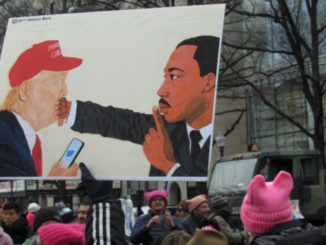 A poster at the third annual Women's March on Jan. 19. (Photo By George Kevin Jordan)