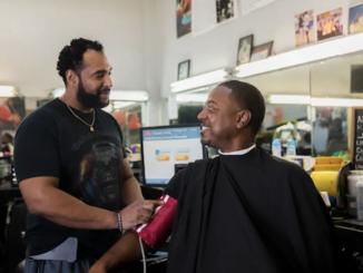**FILE** Barber Eric Muhammad (left) and customer Mark Sims (Smidt Heart Institute at Cedars-Sinai)