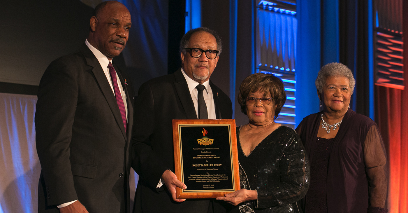 Rosetta Miller Perry (third from left), Publisher of the Tennessee Tribune, receives the National Newspaper Publishers Association's (NNPA) Lifetime Achievement Award. Pictured with Ms. Perry are (from left to right): Thurmon Jones, Publisher of the North Dallas Gazette, Dr. Benjamin F. Chavis, Jr., NNPA President and CEO, Dorothy R. Leavell, Publisher of the Chicago Crusader and NNPA Chairman