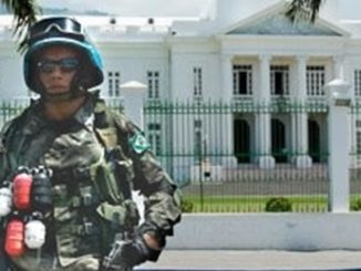 U.N. soldier in front of Haiti White House (Photo by: Global Information Network)