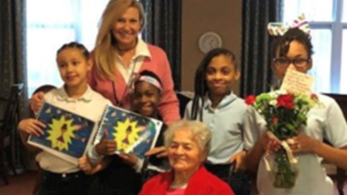 The students in teacher Julie Dellecave's fourth-grade class at Winton Hills Academy hold their book about Cincinnati Civil Rights icon Marian Spencer, center, after writing and illustrating the award-winning book about her and her amazing accomplishments. The students, from left, are Janyia New, Aliyana O'Neal, Nakiyah Ray and Serenity Mills. Dellacave is in back. Photo provided