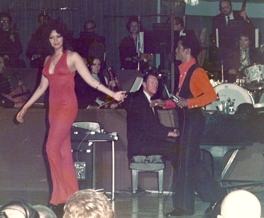 Kathrine McKee and Sammy Davis Jr. on stage.