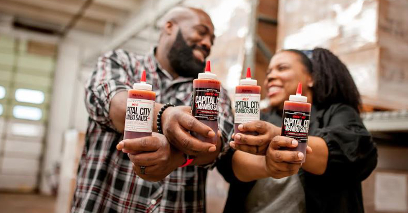 Charles and Arsha Jones are a husband and wife duo that started the brand Capital City Mambo Sauce and recently collaborated with local Papa John's locations. (Courtesy Photo)