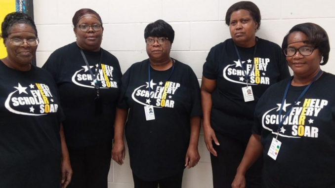 Everyone from the bus drivers to the front desk staff, to the cafeteria staff wears their HERO shirt.