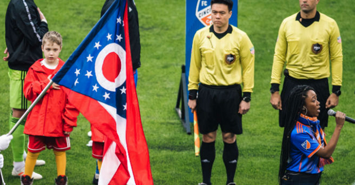 Lauren Eylise, of Cincinnati, sings the National Anthem to kickoff FC Cincinnati's first home game in Major League Soccer. (Photo by: Ray Ball)