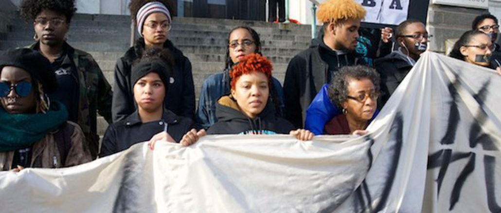 Maryland Institute College of Art Deyane Moses (front center) stands with other students on the school's steps. (Photo by Lia Latty)