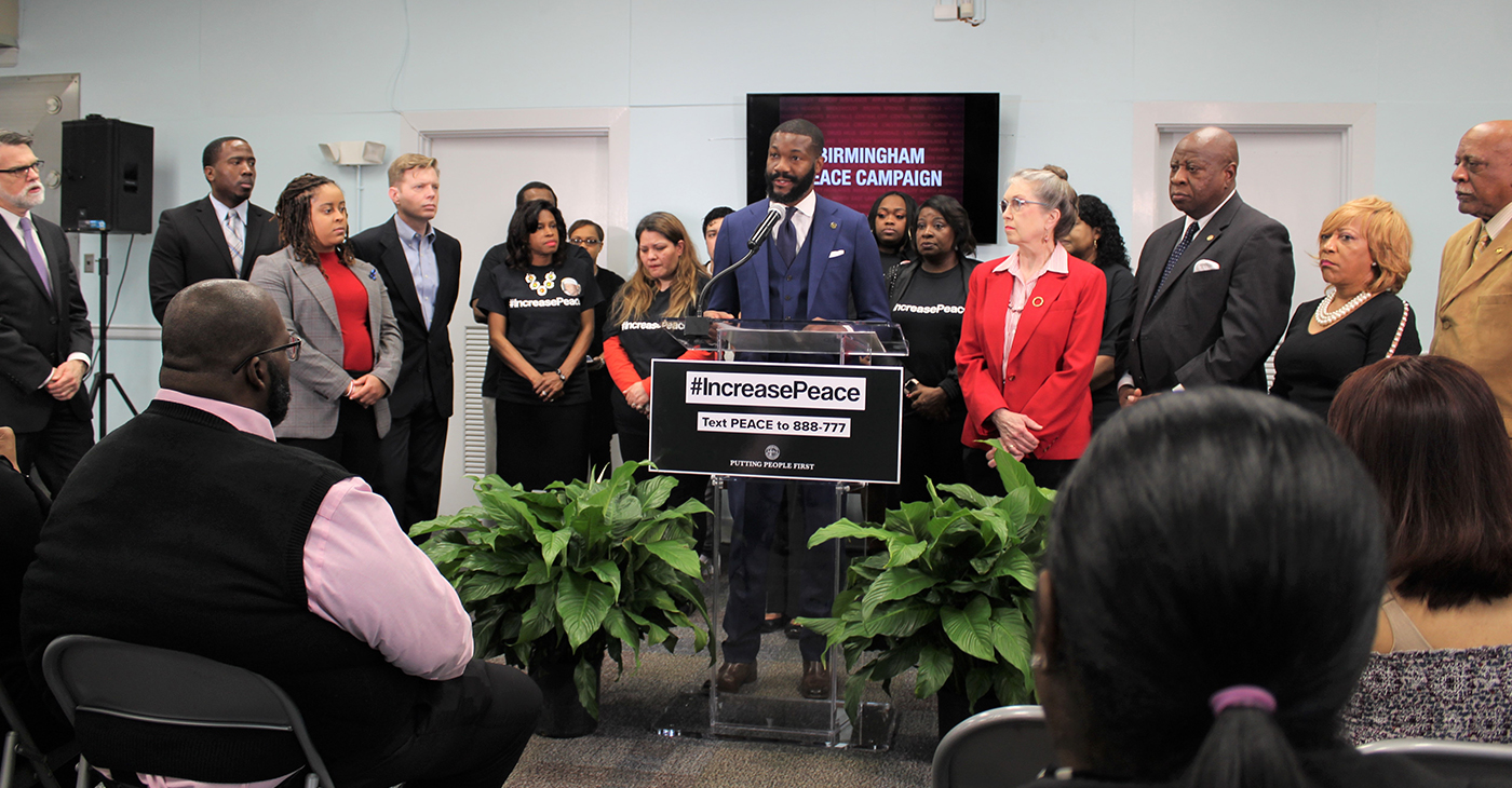 Mayor Randall Woodfin (center) speaks during an event unveiling the city's peace plan to end gun violence.. Woodfin has called it a 'public health crisis'. (Ameera Steward Photos, The Birmingham Times)