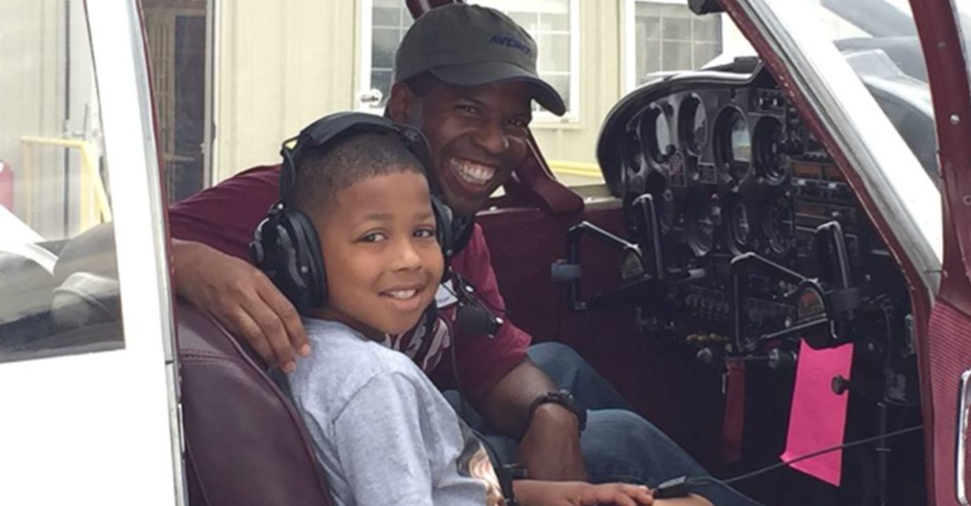 Next Generation Pilots attending the Eyes Above the Horizon aviation camp in Tuskegee, Ala. experience the thrill of sitting in a helicopter cockpit.