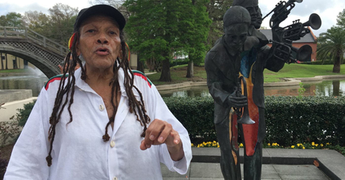 Tour guide Sakura Konē explaining the history of Buddy Bolden's statue
