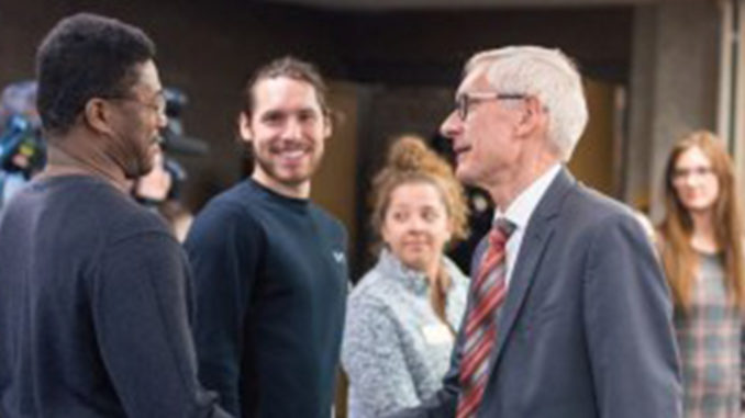Gov. Tony Evers made sure to say hello to everyone in the room. (Picture taken from UWM by Elora Hennessy)