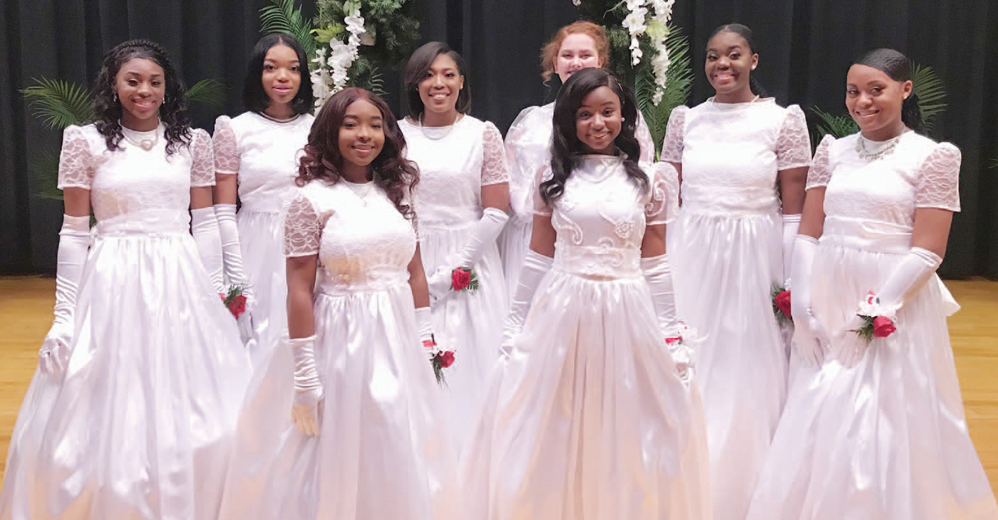 The newest inductees of the 2019 debutante and debonair society stand proudly before being presented to society. Back Row (From left to right): Brikyia Benjamin, Erin Logan Owens, Ar'Nyya Walden, Ivy Jones, Iyana Sharmine Morgan, Naloni Lecal Moore. Front Row (from left to right): Semiyah Patrice Smith and Gabrielle Natania Joseph