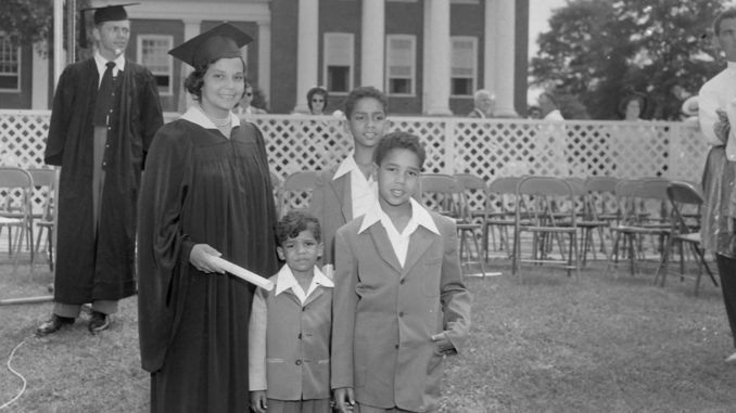 University of Maryland School of Law graduate Juanita Jackson Mitchell in cap and gown with her sons Clarence M. Mitchell III, Keiffer Mitchell, and Michael Bowen Mitchell. College Park, Maryland./Photo By Paul Henderson, circa 1950. Maryland Historical Society, HEN.00.B1-043.