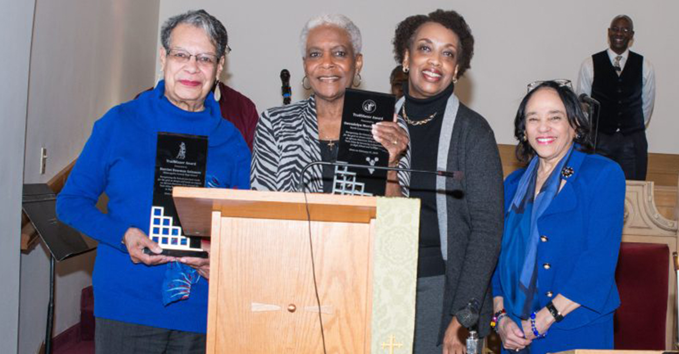 Two trailblazing cheerleaders were recognized at St. Peter's Church in Minneapolis: (l-r) Harriet Bowman Solomon, Gwendolyn Morrow Fraction; Rev. Carla Mitchell, pastor of St. Peter's; and former Minneapolis Public Schools.superintendent Dr. Carolyn Johnson.