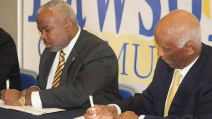 Alabama State President Dr. Quinton Ross Jr. (left) and Lawson State President Dr. Perry Ward sign memorandum of understanding between the two institutions. (Photo by: Ameera Steward | The Birmingham Times)