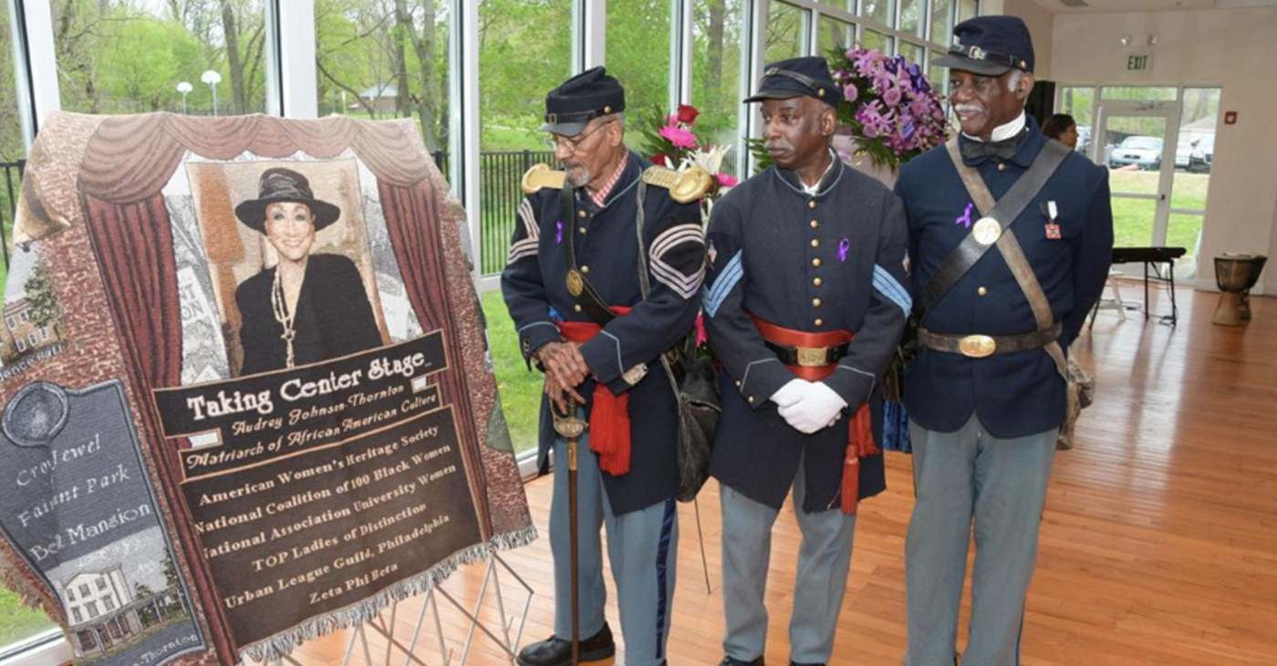 Buffalo Soilders admire a picture of Audrey Patrick Johnson-Thorton (Photo by: Adbul R. Sulayman | Philadelphia Tribune)