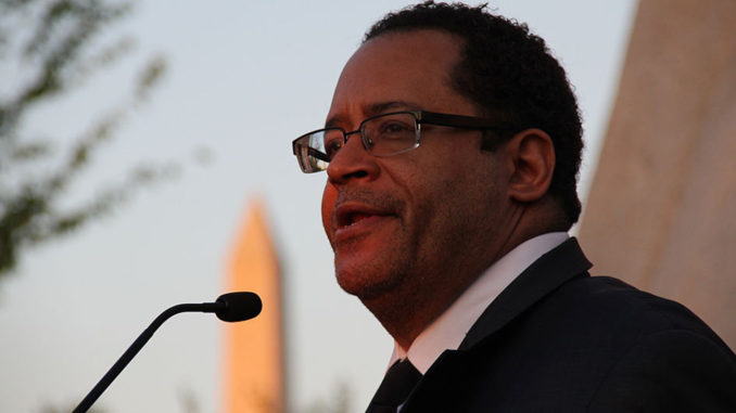 Michael Eric Dyson attending a candlelight vigil on the 44th anniversary of Martin Luther King, Jr.'s assasination, at the MLK memorial in Washington D.C. (Photo by:Jean Song/MEDILL | Wiki Commons)
