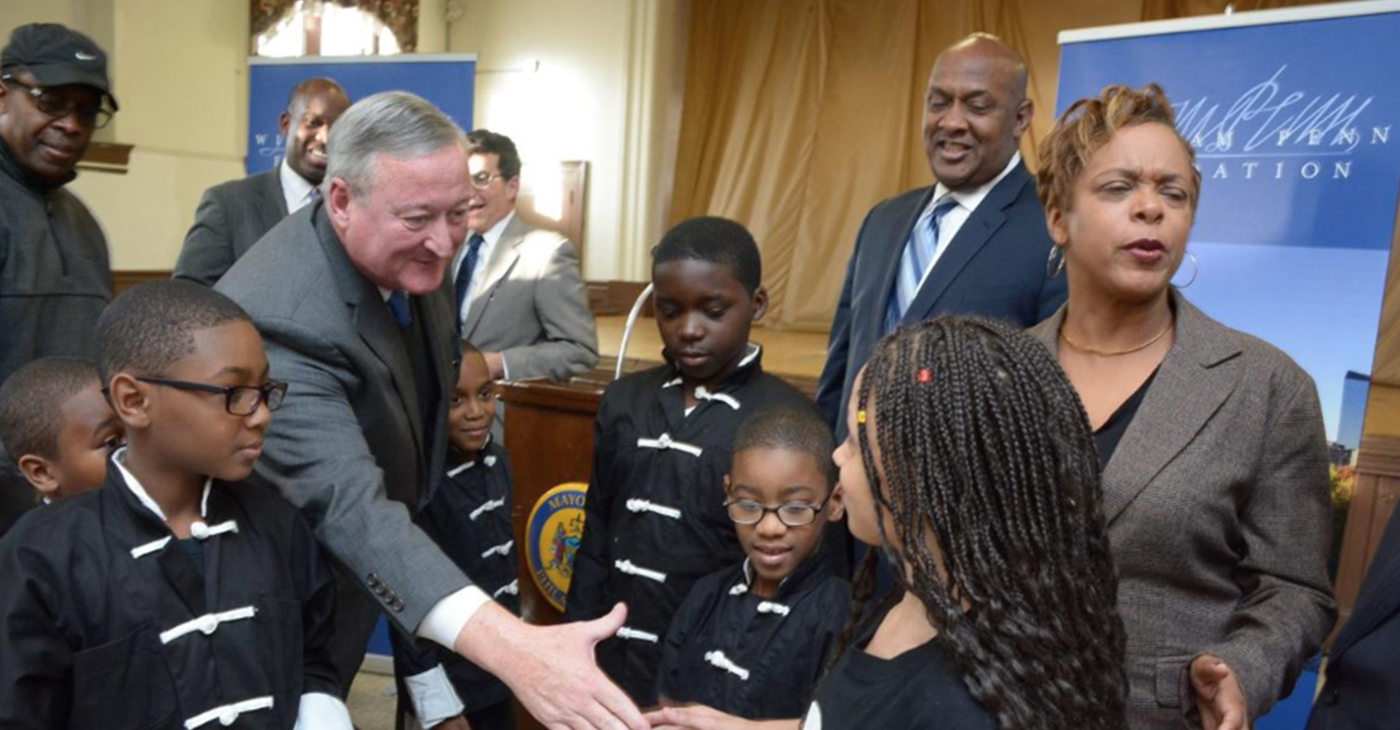 In this Tribune file photo, Mayor Jim Kenney greets Michelle Ramos, a member of the Shaolin Knights, which practices at the Cecil B. Moore Recreation Center in North Philadelpha. The recreation center will be revamped as part of the Rebuild initative - (Photo By: Abdul Sularyman/Tribne Chief Photgrapher)