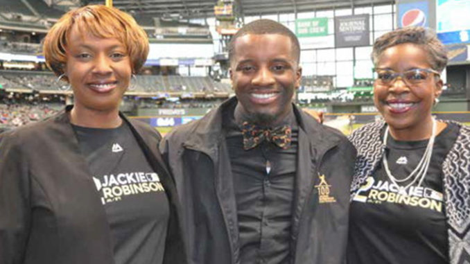 54761975620 Brian Diggs (center) is pictured with Milwaukee Brewers Community Relations  Vice President Katina Shaw
