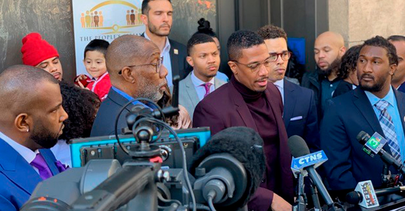 Nick Cannon standing with The People's Alliance For Justice Founder Rev. Shane Harris and supporters for AB 329, a bill aimed to reduce police use of force.